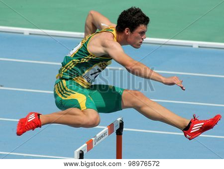 BARCELONA - JULY, 11: Bernardus Pretorius of South Africa during 400m hurdles event of the 20th World Junior Athletics Championships at the Stadium on July 11, 2012 in Barcelona, Spain