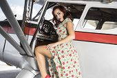 Vacation, pinup dressed in era of the Second World War, beauty redheaded woman poster
