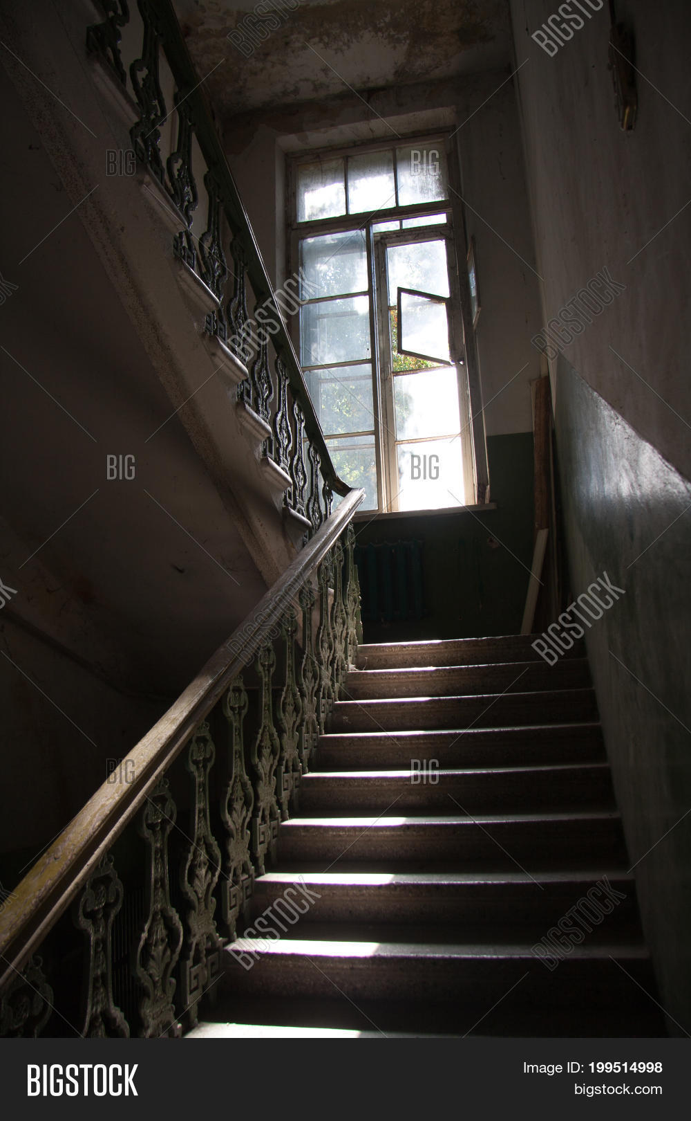 Dark Vintage Staircase Interior In Old Building, Stair With Forged Railing,  Big Window With