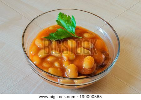 Baked beans in tomato sauce on the table.