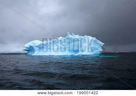 Beautiful iceberg or ice floe, Antarctic ocean, Antarctica poster