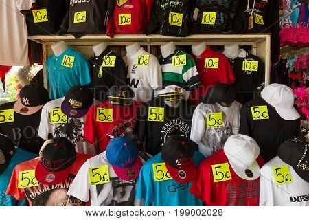 ALANYA TURKEY - JULY 07 2015: Sales to the local market of t-shirts baseball caps and hats. Anatolian coast - a popular holiday destination for European tourists.