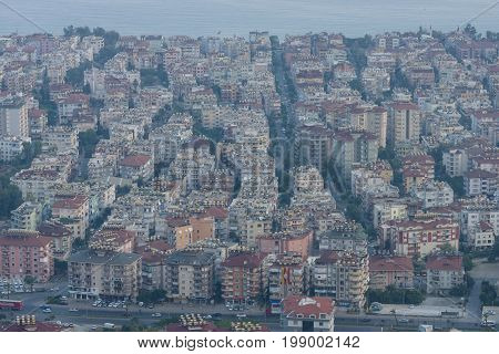 ALANYA TURKEY - JULY 07 2015: View of the residential neighborhoods popular resort town on the Anatolian coast. Dusk. Bird's-eye view.