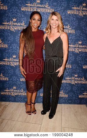 LOS ANGELES - AUG 1:  Holly Robinson Peete, Lori Loughlin at the
