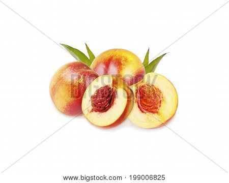 Peaches (nectarine) isolated on white background. Peaches with leaves.