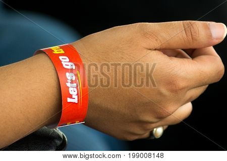 Dark skinned man with an inspirational wrist band given during a racing event