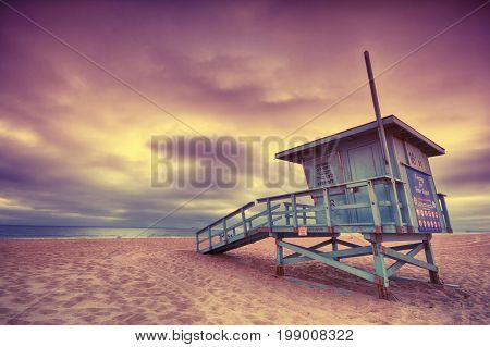 Lifeguard tower with of a sunset at Hermosa Beach California