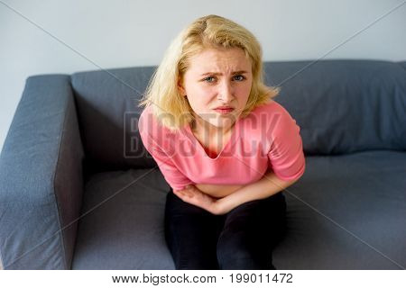 A portrait of a girl suffering from a stomachache