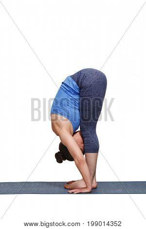 Woman doing yoga asana Uttanasana - standing forward bend pose isolated