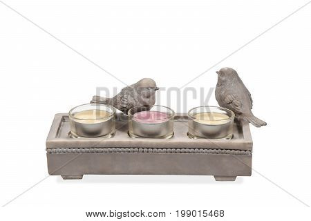 Decorative ceramic candlestick with bird figurines isolated on white background