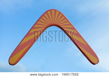 Wooden Australian Boomerang In Flight Against Of Pure White Clouds And Blue Sky
