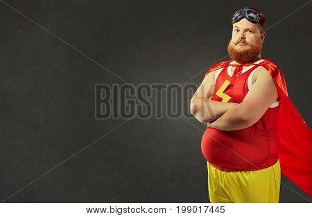 Fat funny freak comic man in a superhero costume.