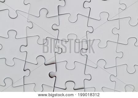 jigsaw puzzle pieces concept .White jigsaw puzzle