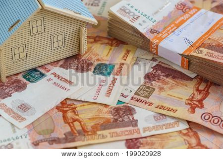 The Concept Of Buying A Residential Property: The Layout Of The House And A Stack Of Russian Rubles