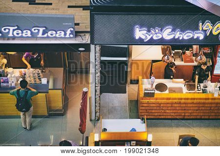 Bangkok, Thailand - January 10, 2016: Food Park in Tesco Lotus Hypermarket on Rama I Road, Bangkok, Thailand. There is the whole floor with food courts where that provide International or Thai dishes
