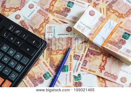 Concept Planning Expenses: Calculator And Ball-point Pen And A Pack Of Half A Million Russian Rubles