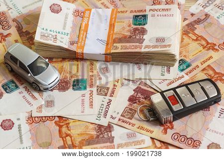 Bundle Of Rouble Bills Of Half A Million Russian Rubles, Silver Model Car And The Ignition Key Are O