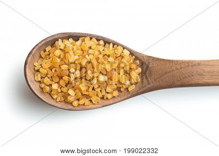 Brown cane sugar in wooden spoon isolated on white background. crystalline brown sugar.