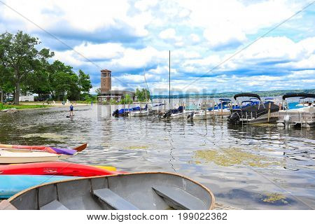 CHAUTAUQUA, NEW YORK - JULY 28, 2017:  Chautauqua Institution offers educational programs to thousands of visitors every summer. as well as recreational activities such as paddle boarding in the lake.