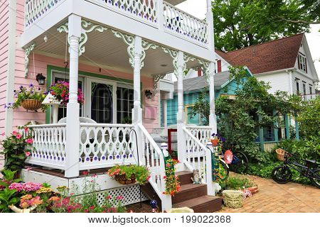 CHAUTAUQUA, NEW YORK - JULY 28, 2017:The property owned by the Chautauqua Institution includes many historic Victorian homes with welcoming porches and colorful gardens.
