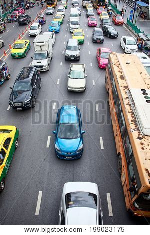 BANGKOK, THAILAND - JULY 30, 2017: City scape traffic on front of Central world. Traffic moves slowly along a busy road in Bangkok,