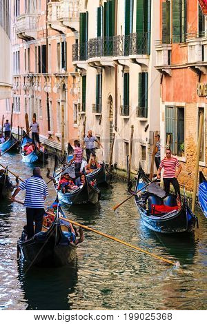 Venice, Italy - July, 28, 2017: gondola on a Channel in Venice, Italy