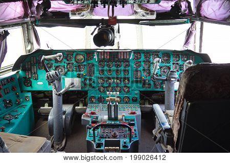 VORONEZH, RUSSIA - AUGUST 28, 2013: Cargo airplane IL-76M cockpit interior. Dashboard and steering wheels