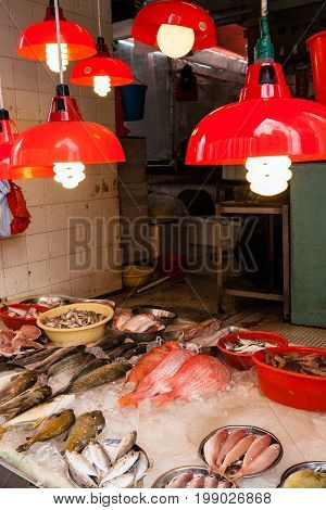 HONG KONG JULY 5 2017: A store selling seafood at a street market in Hong Kong's old residential district of Quarry Bay.