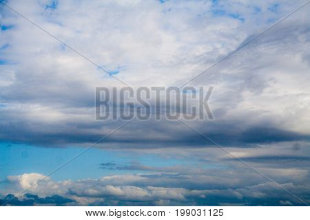Blue sky with gray and white clouds. cumulonimbus. background nature.