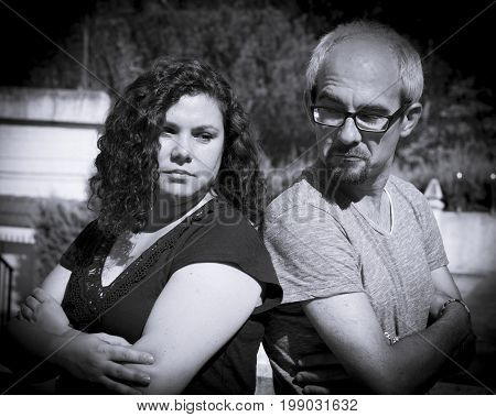 Man and woman back to back angry