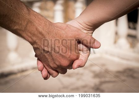 Hands of two lovers intertwined. Love emotion