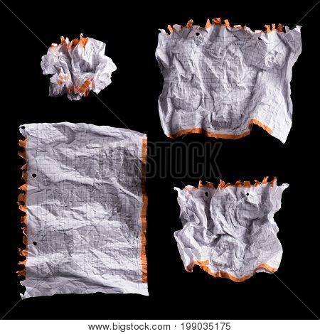 Collection of Crumpled piece of white squared paper exercise book on black background. Set of blank note paper for text writing.
