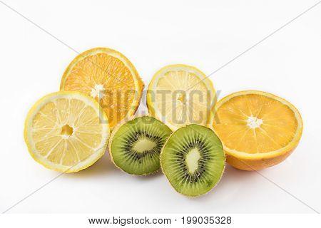 Oranges kiwis and lemons cut in half. Healthy food. On white background.