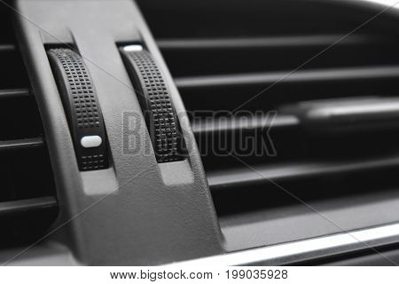 Car air conditioner and switch on/off compartment.
