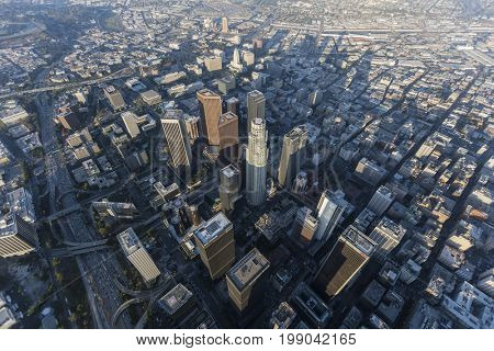 Los Angeles, California, USA - August 7, 2017:  Hazy afternoon aerial view of urban downtown streets and towers.