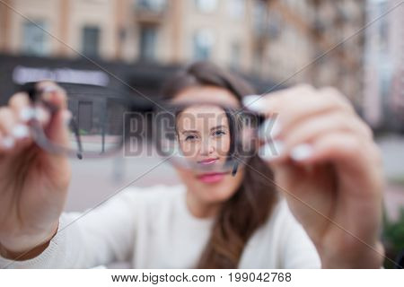 Closeup Portrait Of Young Women With Glasses. She Has Eyesight Problems And Is Squinting His Eyes A