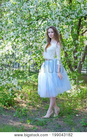 beauty young woman in the apple garden