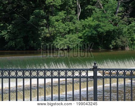 The Sheboygan River flows over the dam at Settlers Park in Sheboygan Falls, Wisconsin on its way to Lake Michigan.