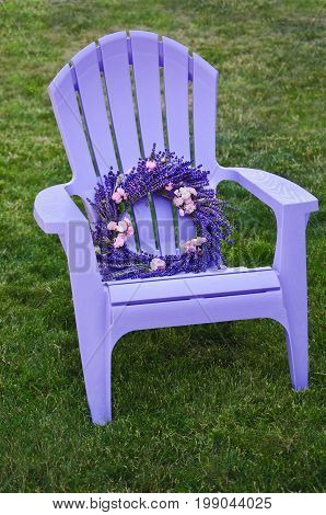 Purple lawn chair with lavender and fairy rose wreath
