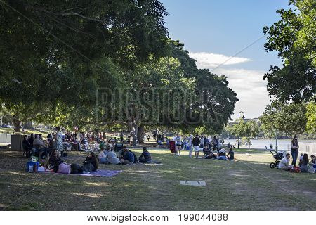 BRISBANE, AUSTRALIA - August 6, 2017: People enjoying the warm weather of a winter Sunday in New Farm Park Brisbane Australia