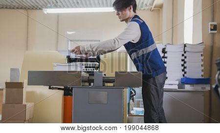 Printing process - feeding sheets of paper, polygraph industry, wide angle, close up - telephoto