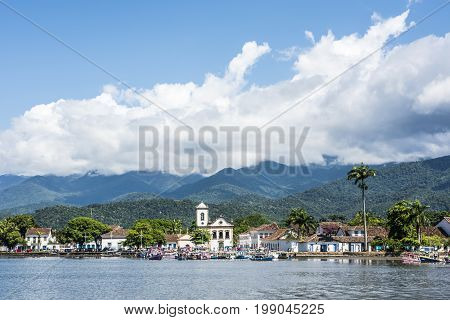 Tourist Boats Waiting For Tourists Near The Church Igreja De Santa Rita De Cassia In Paraty, State R