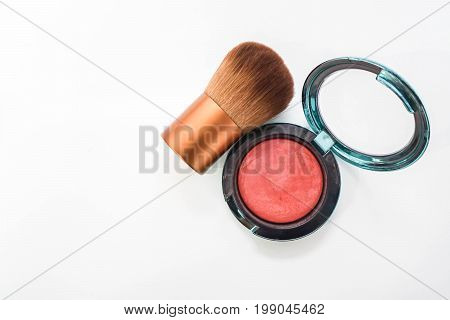 Isolated red orange brush on with cheek brush for women beauty