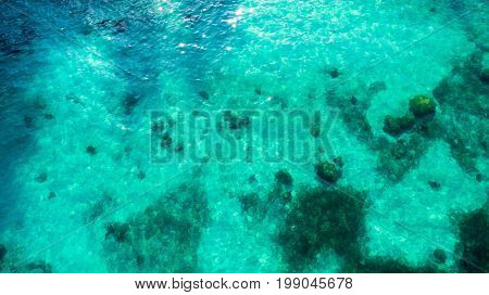 Beautiful clear turquoise seawater at tropical beach in summer - natural background concept