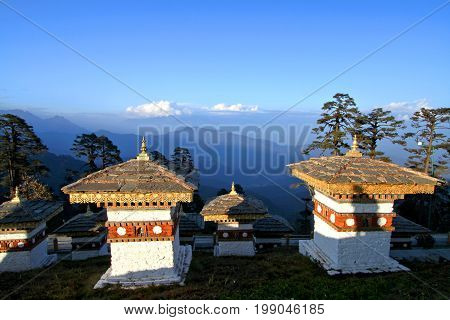 The 108 chortens (stupas) is the memorial in honour of the Bhutanese soldiers with layer of mountains at Dochula Pass on the road from Thimphu to Punaka Bhutan