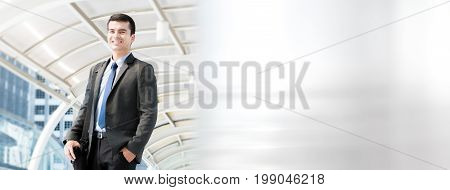 Handsome hispanic businessman carrying bag going to work - panoramic web banner with copy space