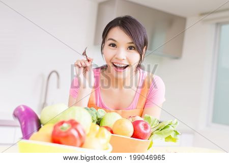beauty housewife take fork and smile happily in kitchen