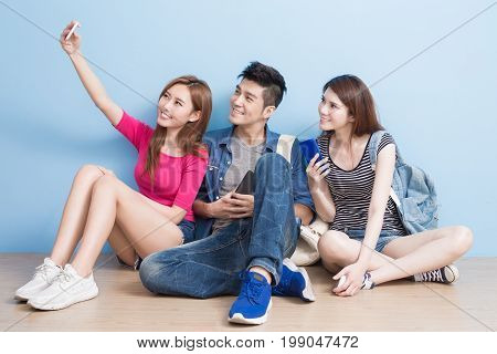 student selfie happily and sit on the floor
