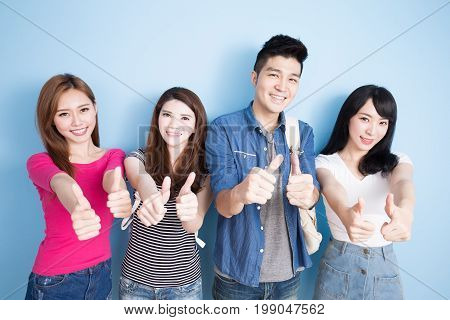 happy group student show thumb up on the blue background