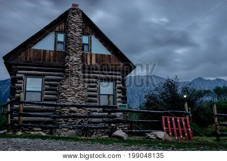 log cabin in mountainous woods at the base of Ragged Mountain in Colorado